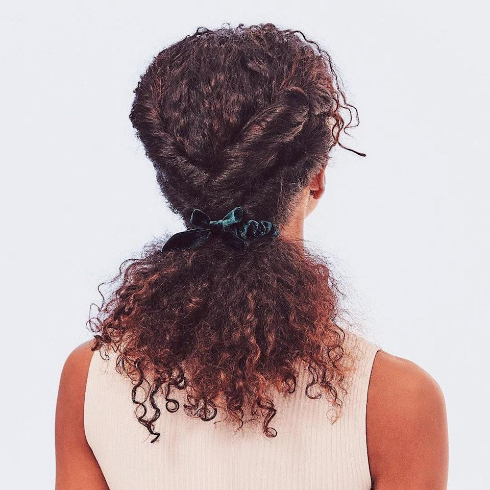 Starting at the top, add some dimension by twisting two sections—one right on top of the other—from either side of your head.