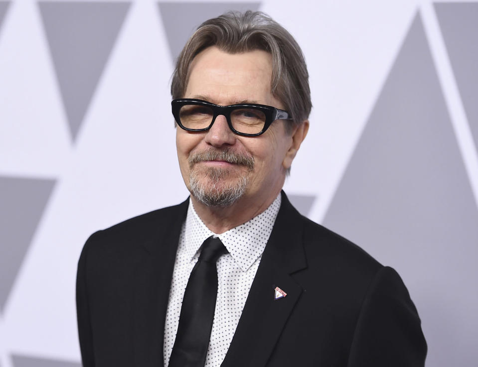"""FILE - Gary Oldman arrives at the 90th Academy Awards Nominees Luncheon in Beverly Hills, Calif., on Feb. 5, 2018. Oldman, 62, portrays Herman Mankiewicz, who wrote """"Citizen Kane"""" before drinking himself to death at the age of 55, in the David Fincher film """"Mank."""" (Photo by Jordan Strauss/Invision/AP, File)"""