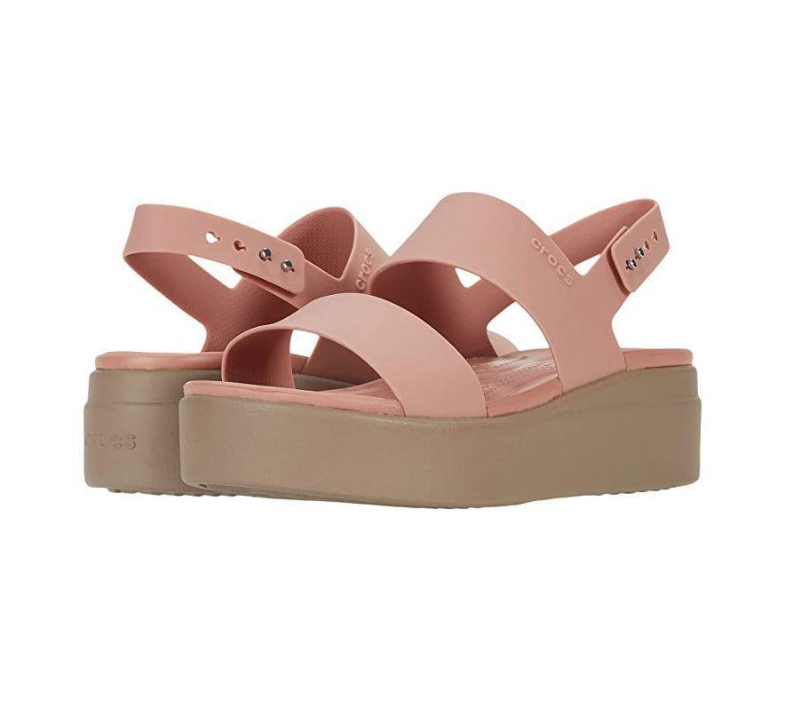 """<p><strong>Crocs</strong></p><p>zappos.com</p><p><strong>$54.99</strong></p><p><a href=""""https://go.redirectingat.com?id=74968X1596630&url=https%3A%2F%2Fwww.zappos.com%2Fp%2Fcrocs-brooklyn-low-wedge%2Fproduct%2F9335547&sref=https%3A%2F%2Fwww.prevention.com%2Fbeauty%2Fstyle%2Fg36040203%2Fcomfortable-wedge-sandals%2F"""" rel=""""nofollow noopener"""" target=""""_blank"""" data-ylk=""""slk:Shop Now"""" class=""""link rapid-noclick-resp"""">Shop Now</a></p><p>Crocs are known for their comfy footwear, and these wedges don't disappoint. The two-strap silhouette and adjustable ankle strap give you excellent foot security, and the flexible material <strong>make them feel broken-in immediately</strong>. They're also the perfect height at 1.7 inches. Bonus: You can snag them in a variety of colors, from everyday black to summery pale blush. """"You really can't go wrong with these lightweight, wedge sandals,"""" Dr. Perkins says.</p>"""