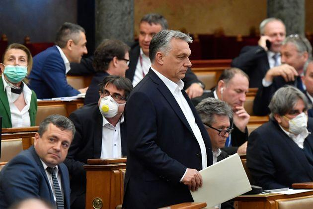 Hungarian Prime Minister Viktor Orban (standing) at the session of the Hungarian Parliament in Budapest on Monday where his government gained sweeping powers amid the coronavirus crisis. Critics express deep concerns about how he will wield his new authority.