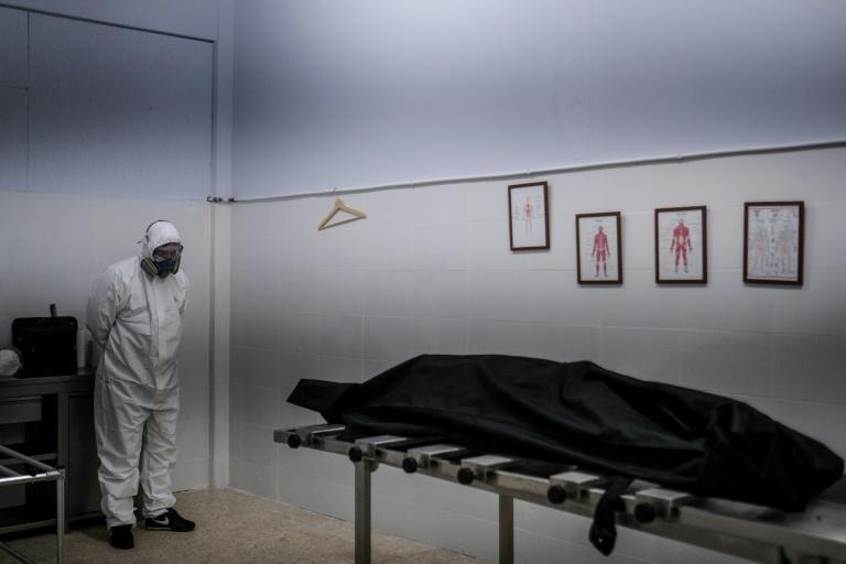 At a funeral parlour in the outskirts of Lisbon, staff are straining to cope with all the bodies piling up due to Covid