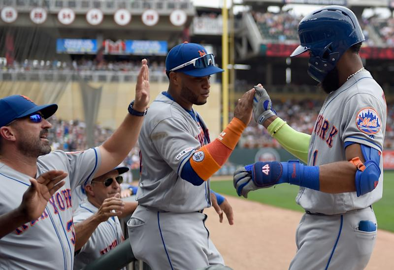 MINNEAPOLIS, MN - JULY 17: manager Mickey Callaway #36 and Robinson Cano #24 of the New York Mets congratulate Amed Rosario #1 on a solo home run against the Minnesota Twins during the third inning of the interleague game on July 17, 2019 at Target Field in Minneapolis, Minnesota. a(Photo by Hannah Foslien/Getty Images)