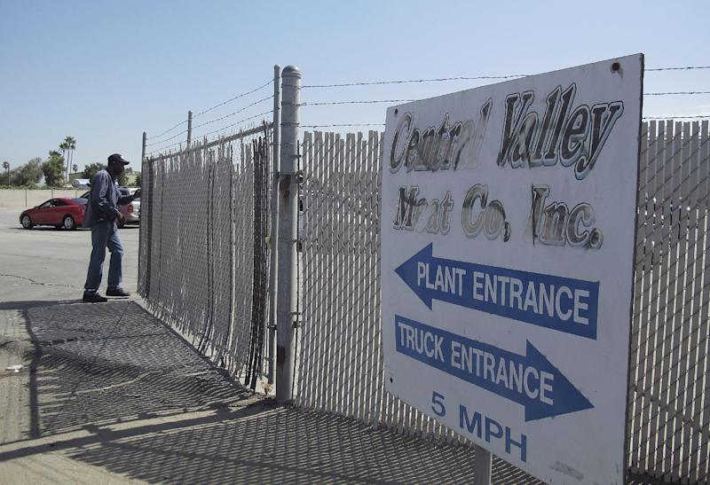 A security guard opens the gate at the Central Valley Meat Co., the California slaughterhouse shut down by federal regulators after they received video showing dairy cows being repeatedly shocked and shot before being slaughtered, on Tuesday, Aug. 21, 2012 in Hanford, Calif. Federal regulators are investigating whether beef from sick cows reached the human food supply. (AP Photo/Gosia Wozniacka)