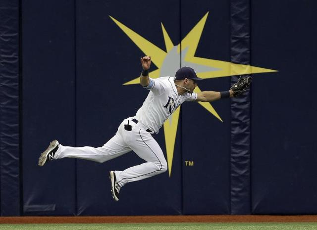 Rays outfielder Kevin Kiermaier wowed again during Friday's marathon against the Red Sox. (AP)