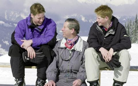 The Prince of Wales and his sons, Prince William (left) and Prince Harry, pose for photographers on the Madrisa ski slopes above Klosters - Credit: John Stillwell/PA