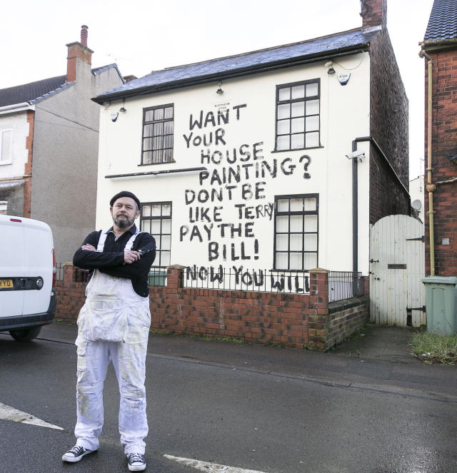 """The graffiti reads: """"€œWant your house painting? Don't be like Terry, pay the bill! Now you will!"""" (SWNS)"""