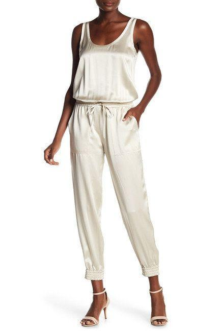 "Get it on <a href=""https://www.nordstromrack.com/shop/product/2278361/theory-hekuba-silk-jumpsuit?color=SANDY%20WHITE"" target=""_blank"">Nordstrom Rack for $170</a>."