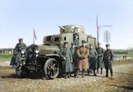 <p>German officers stand by an armoured car in Ukraine in early 1918 (Royston Leonard / Media Drum World / Caters News) </p>