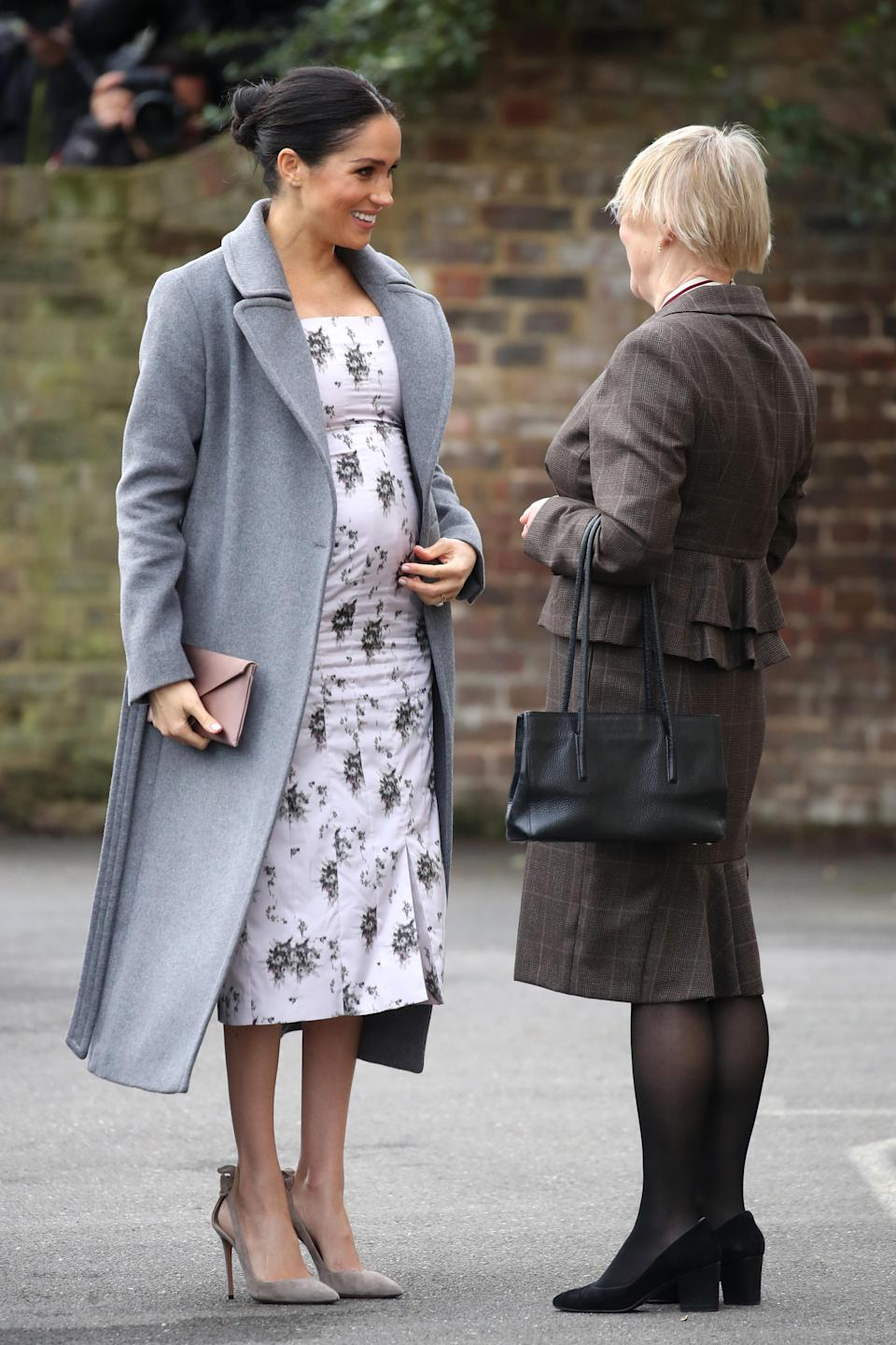 <p>For a trip to Brinsworth House, Meghan wore a £435 Soia and Kyo coat over a £834 floral print midi dress by Brock Collection. She finished the outfit with her go-to £510 Aquazzura 'Deneuve' suede pumps and a £205 Wilbur & Gussie silk oyster clutch bag. She also wore her £1,350 Maison Birks Pétale yellow gold and diamond stud earrings. <em>[Photo: Getty]</em> </p>