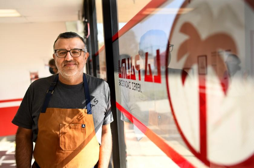 SANTA ANA, CALIFORNIA NOVEMBER 20, 2020-Albert Banuelos stands inside his store Burritos La Palma in Santa Ana. The business experienced a a steep downfall due to the coronavirus but has since had a huge upswing after the appearance on a Netflix taco show. (Wally Skalij/Los Angeles Times)