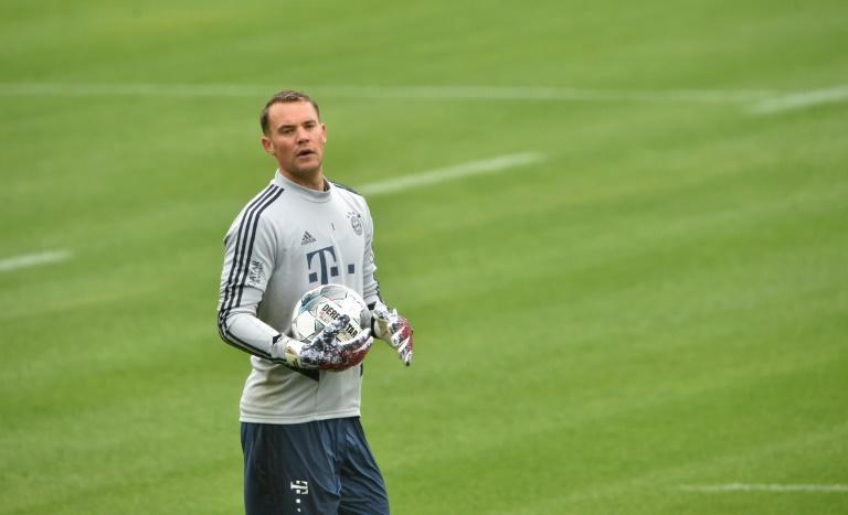 Neuer says Bundesliga footballers must be role models when the league returns next week (AFP Photo/Christof STACHE)