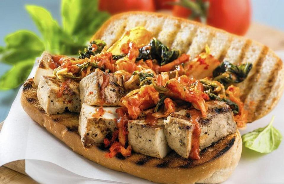 """<p>Po'boys are a staple in <a href=""""https://www.thedailymeal.com/cook/louisiana-cajun-creole-mardi-gras-recipes?referrer=yahoo&category=beauty_food&include_utm=1&utm_medium=referral&utm_source=yahoo&utm_campaign=feed"""" rel=""""nofollow noopener"""" target=""""_blank"""" data-ylk=""""slk:Louisianan cuisine"""" class=""""link rapid-noclick-resp"""">Louisianan cuisine</a> and are often served with shrimp or crawfish. This vegetarian rendition of the dish uses tofu, which has a meaty texture that resembles the consistency of seafood.</p> <p><a href=""""https://www.thedailymeal.com/recipes/tofu-po-boy?referrer=yahoo&category=beauty_food&include_utm=1&utm_medium=referral&utm_source=yahoo&utm_campaign=feed"""" rel=""""nofollow noopener"""" target=""""_blank"""" data-ylk=""""slk:For the Tofu Po'boy recipe, click here."""" class=""""link rapid-noclick-resp"""">For the Tofu Po'boy recipe, click here.</a></p>"""
