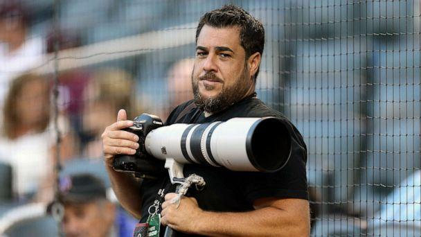 PHOTO: In this Aug. 2, 2016, photo provided by Christopher Pasatieri, New York Post photographer Anthony J. Causi is shown before a New York Mets baseball game in New York. Causi died Sunday, April 12, 2020, from the new coronavirus. He was 48. (Christopher Pasatieri via AP)
