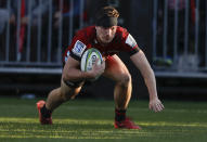 Crusaders George Bridge scores hits first try during the Super Rugby Aotearoa rugby game between the Crusaders and the Highlanders in Christchurch, New Zealand, Sunday, Aug. 9, 2020. (AP Photo/Mark Baker)