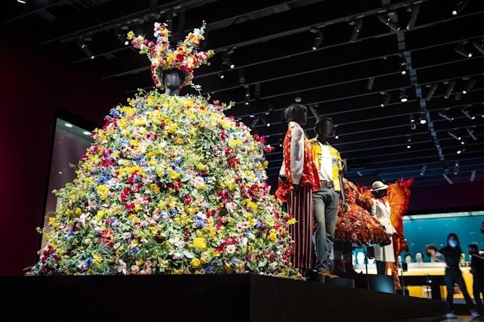 A large dress made of flowers and a headpiece made of flowers