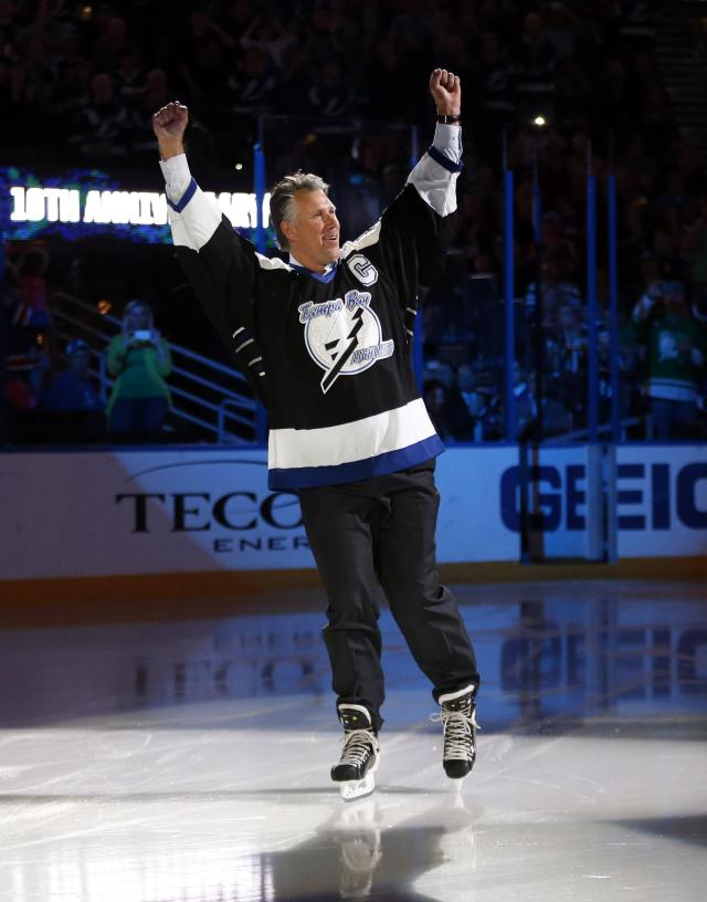 TAMPA, FL - MARCH 17: Dave Andreychuk, former captain of the Tampa Bay Lightning, is introduced as part of the team's celebration of the tenth anniversary of their Stanley Cup win prior to a game against the Vancouver Canucks at the Tampa Bay Times Forum on March 17, 2014 in Tampa, Florida. (Photo by Mike Carlson/Getty Images)