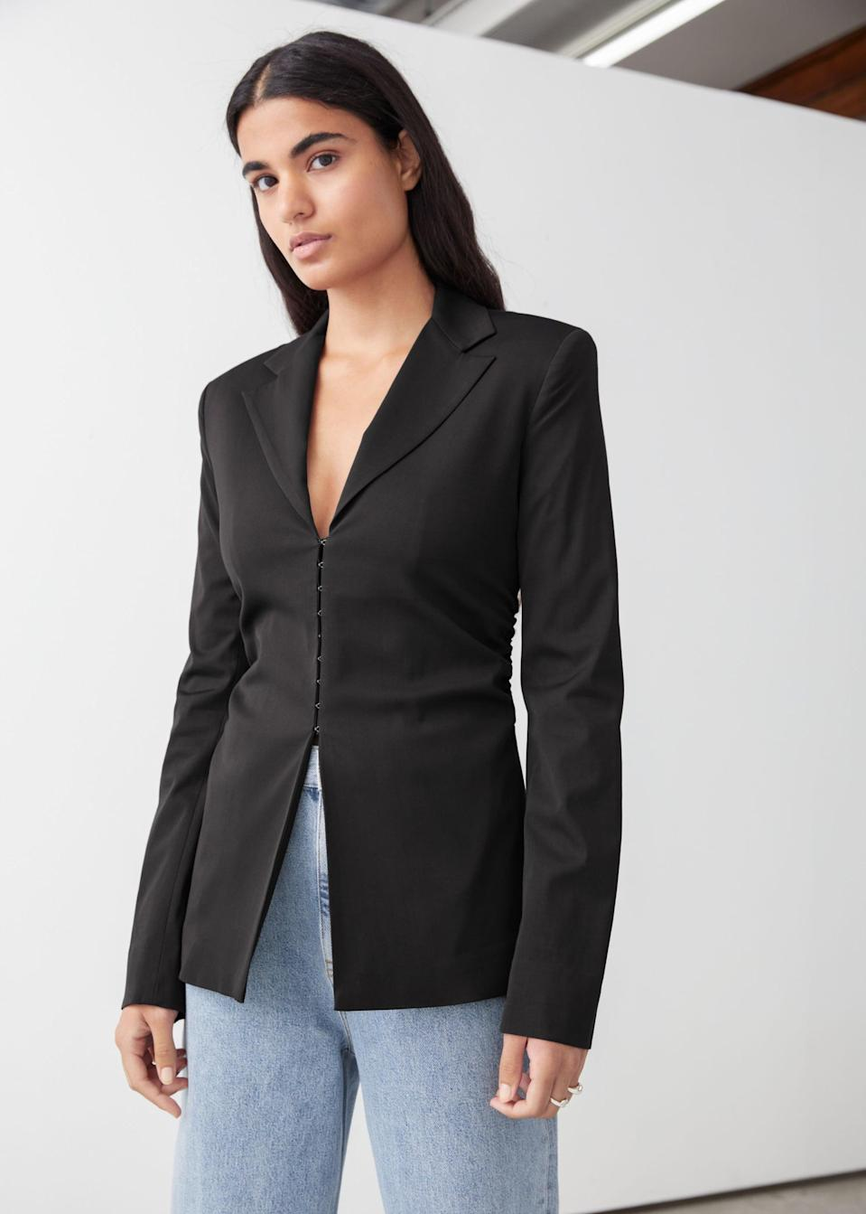 <p>This <span>Tailored Padded Shoulder Blouse</span> ($119) will be the talk of your meetings.</p>