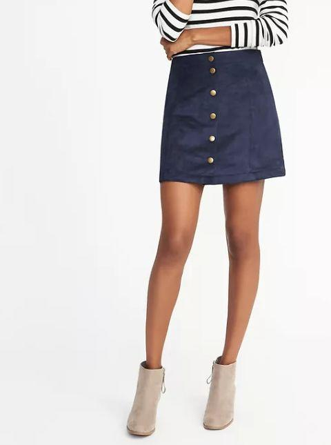 "These <a href=""http://oldnavy.gap.com/browse/product.do?pid=821787022&vid=1&locale=en_US&kwid=1&sem=false&sdkw=sueded-snap-front-mini-for-women-P821787&sdReferer=https%3A%2F%2Fwww.google.com%2F"" target=""_blank"">Old Navy skirts</a> are cute, stylish and easily paired with fall essentials like cardigans, turtlenecks and boxy sweaters."