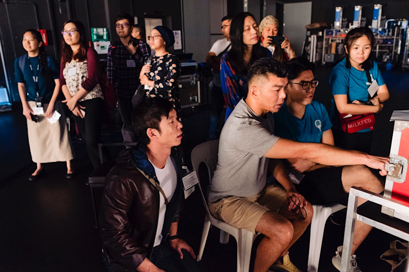 Foreground, L-R: creative producer Benjamin Tan, filmmaker Royston Tan and filmmaker Alvin Lee. The music video shoot of Majulah Singapura on 22 October 2019, a project conceived by events creative director Benjamin Tan, performed by Ramli Sarip and featuring Singaporeans representing different notions of progress. (PHOTO: SidexSide Photography)