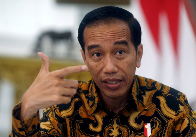 FILE PHOTO: Indonesia's President Joko Widodo gestures during an interview with Reuters in Jakarta