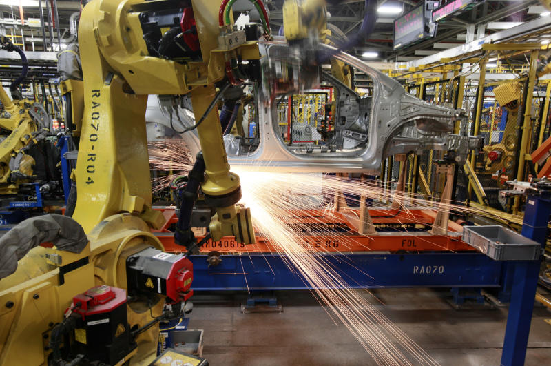 In this May 19, 2011 photo, robots weld a pre-production Chevrolet Sonic at the General Motors Orion Assembly plant in Orion Township, Mich. U.S. manufacturing activity expanded in May at the slowest pace in 20 months, the latest sign that the sharp rise in energy prices is hampering economic growth.(AP Photo/Paul Sancya)