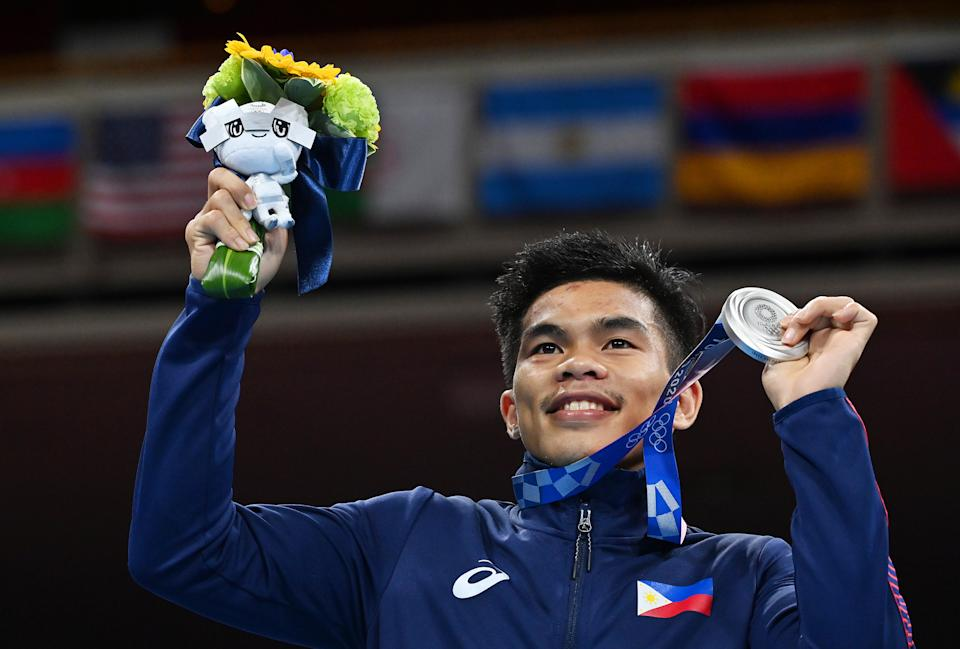 The Philippines' Carlo Paalam poses on the podium with his silver medal during the medal ceremony for the men's flyweight at the 2020 Tokyo Olympics.