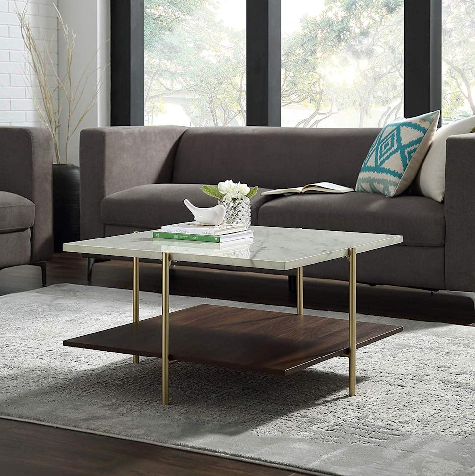 <p>If you love brass accents and marble textures, this <span>WE Furniture Coffee Table </span> ($221) is for you. The mix of finishes makes it unique.</p>