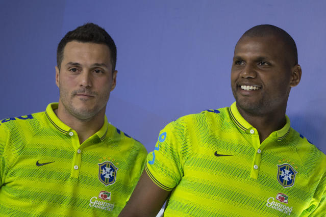 Brazil's goalkeepers Julio Cesar, left, and Jefferson leave after a news conference at the Granja Comary training center in Teresopolis, Brazil, Tuesday, May 27, 2014. Brazil is hosting the World Cup soccer tournament which starts in June. (AP Photo/Felipe Dana)