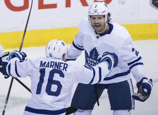 Toronto Maple Leafs' Ron Hainsey, back right, and Mitchell Marner celebrate Hainsey's goal against the Vancouver Canucks during the second period of an NHL hockey game Wednesday, March 6, 2019, in Vancouver, British Columbia. (Darryl Dyck/The Canadian Press via AP)
