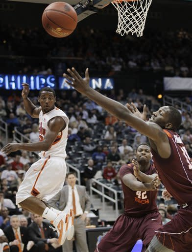 CORRECTS CLEMSON PLAYER TO DEVIN COLEMAN, INSTEAD OF TANNER SMITH - Clemson guard Devin Coleman watches as Virginia Tech guard Erick Green (11) reach for the ball, as Virginia Tech forward C.J. Barksdale (42) looks on during the first half of an NCAA college basketball game in the first round of the men's Atlantic Coast Conference tournament, Thursday, March 8, 2012, in Atlanta. (AP Photo/Chuck Burton)
