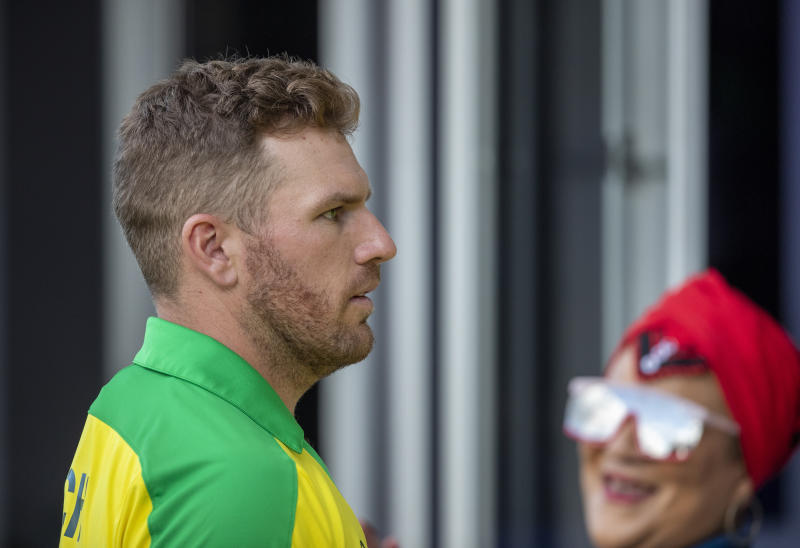 Australia's captain Aaron Finch walks back to the players pavilion at the end of the 2nd T20 cricket match between South Africa and Australia at St George's Park in Port Elizabeth, South Africa, Sunday, Feb. 23, 2020. South Africa beat Australia by 12 runs. (AP Photo/Themba Hadebe)