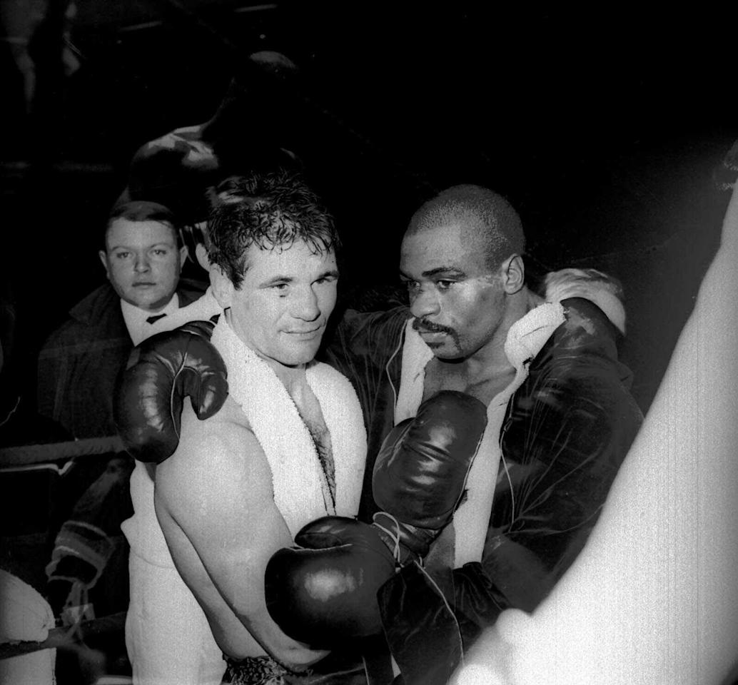 "FILE - In this Feb. 23, 1965 file photo, Rubin ""Hurricane"" Carter and Italian boxer Fabio Bettini pose after a fight at the Palais des Sports in Paris. Carter, who spent almost 20 years in jail after twice being convicted of a triple murder he denied committing, died at his home in Toronto, Sunday, April 20, 2014, according to long-time friend and co-accused John Artis. He was 76. (AP photo/Bedini, File)"