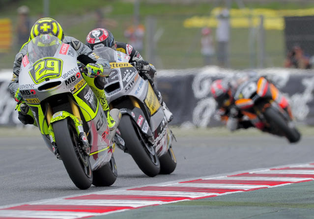 Speed Master's Italian Andrea Iannone (L) rides ahead of Interwetten Paddock's Swiss Thomas Luthi and Team Catalunyacaixa Repsol's Spanish Marc Marquez during the Moto2 race of the Catalunya Moto GP Grand Prix at the Catalunya racetrack in Montmelo, near Barcelona, on June 3, 2012. Speed Master's Italian Andrea Iannone won the race ahead of Interwetten-Paddock's Swiss Thomas Luthi and Team CatalunyaCaixa Repsol 's Spanish Marc Marquez. AFP PHOTO / JOSEP LAGOJOSEP LAGO/AFP/GettyImages