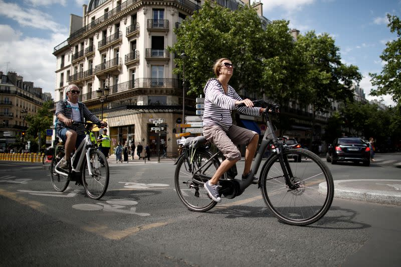 FILE PHOTO: A woman rides an electric bike as the country eases lockdown measures taken to curb the spread of the coronavirus disease (COVID-19) in Paris