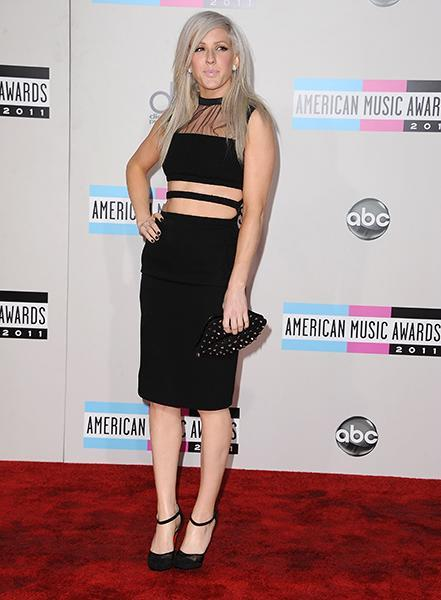 """<div class=""""caption-credit""""> Photo by: Getty Images</div><div class=""""caption-title"""">At the 2011 AMAs</div>Ellie showed up to the awards show in a brave, ab-baring Christopher Kane dress and a quirky Lulu Guinness lip-shaped studded clutch."""