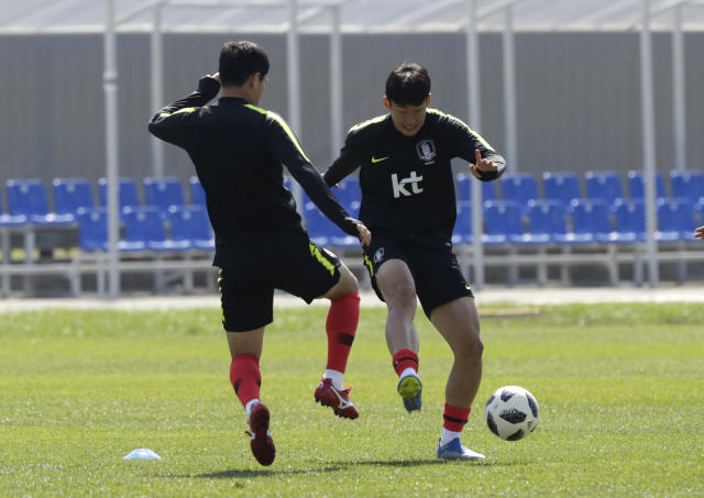 South Korea's Son Heung-min, right, controls the ball against his teammate Ju Se-jong during a training session of South Korea at the 2018 soccer World Cup at the Spartak Stadium in Lomonosov near St. Petersburg, Russia, Saturday, June 16, 2018. (AP Photo/Lee Jin-man)