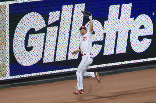 Cincinnati Reds' Shogo Akiyama (4) leaps as he makes a catch on a ball hit by Pittsburgh Pirates' Jacob Stallings (58) in the seventh inning during a baseball game at in Cincinnati, Friday, Aug. 14, 2020. (AP Photo/Aaron Doster)