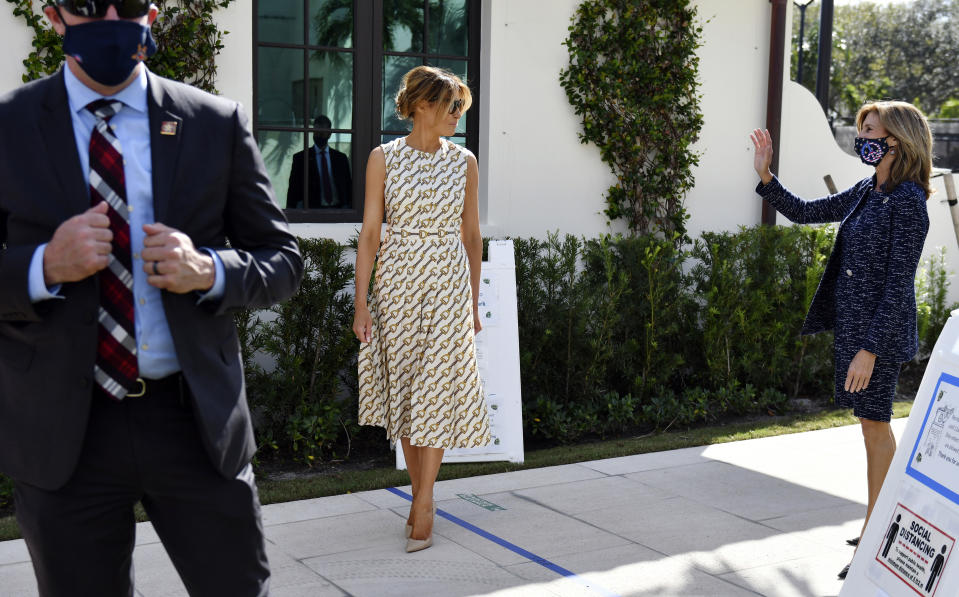 First lady Melania Trump says goodbye to Wendy Sartory Link, Palm Beach County Supervisor of Elections, right, after voting at the Morton and Barbara Mandel Recreation Center, Tuesday, Nov. 3, 2020, in Palm Beach, Fla. (AP Photo/Jim Rassol)