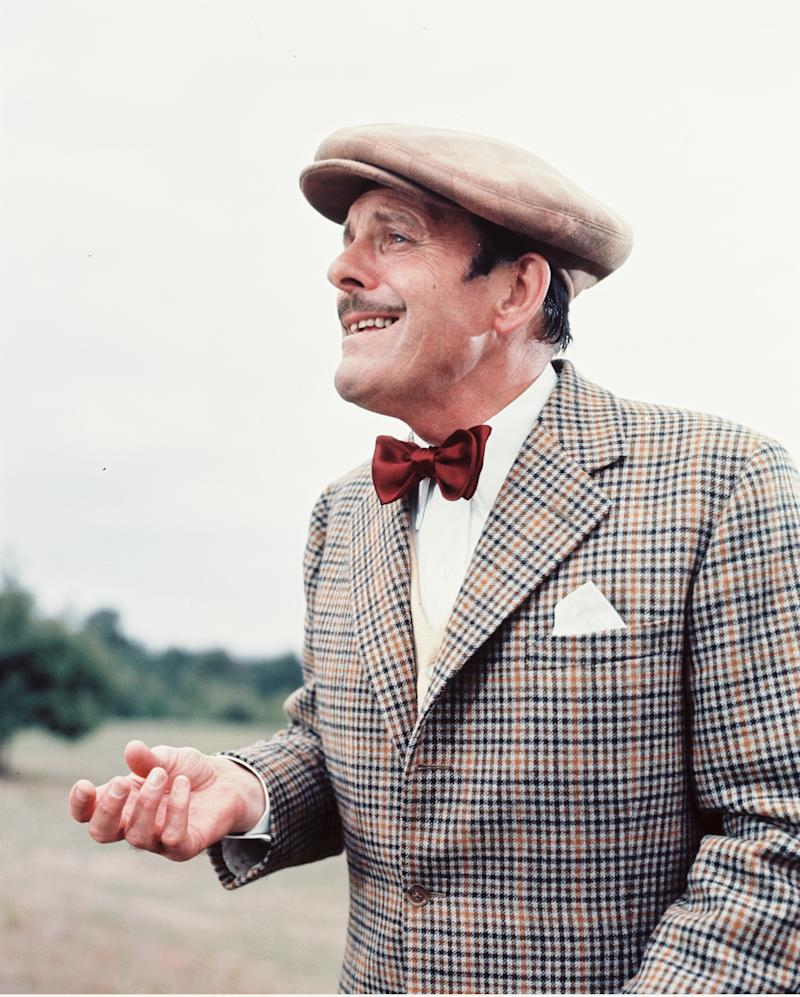 Terry-Thomas (1911-1990), British actor, wearing a tweed jacket, a white shirt and a dark red bow tie with a flat cap in a publicity still issued for the film, 'Monte Carlo or Bust', 1969. The comedy, directed by Ken Annakin (1914-2009), starred Terry-Thomas as 'Sir Cuthbert Ware-Armitage'. (Photo by Silver Screen Collection/Getty Images)