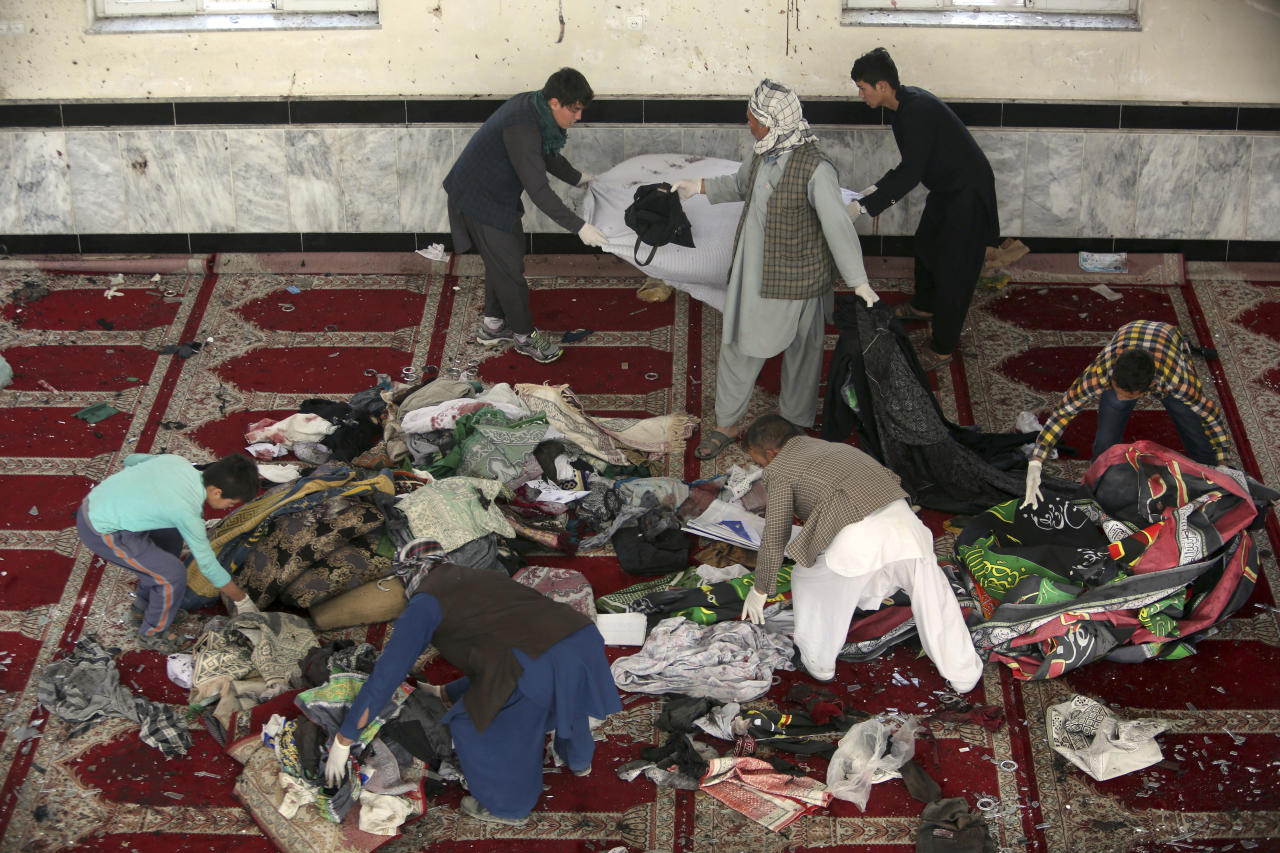 <p> Afghan men collect remains of belongings inside a damaged mosque in Kabul, Afghanistan, Saturday, Oct. 21, 2017, a day after a suicide attack. Suicide bombers struck two mosques in Afghanistan during Friday prayers, the Shiite mosque in Kabul and a Sunni mosque in western Ghor province at the end of a particularly deadly week for the troubled nation. (AP Photo/Rahmat Gul) </p>