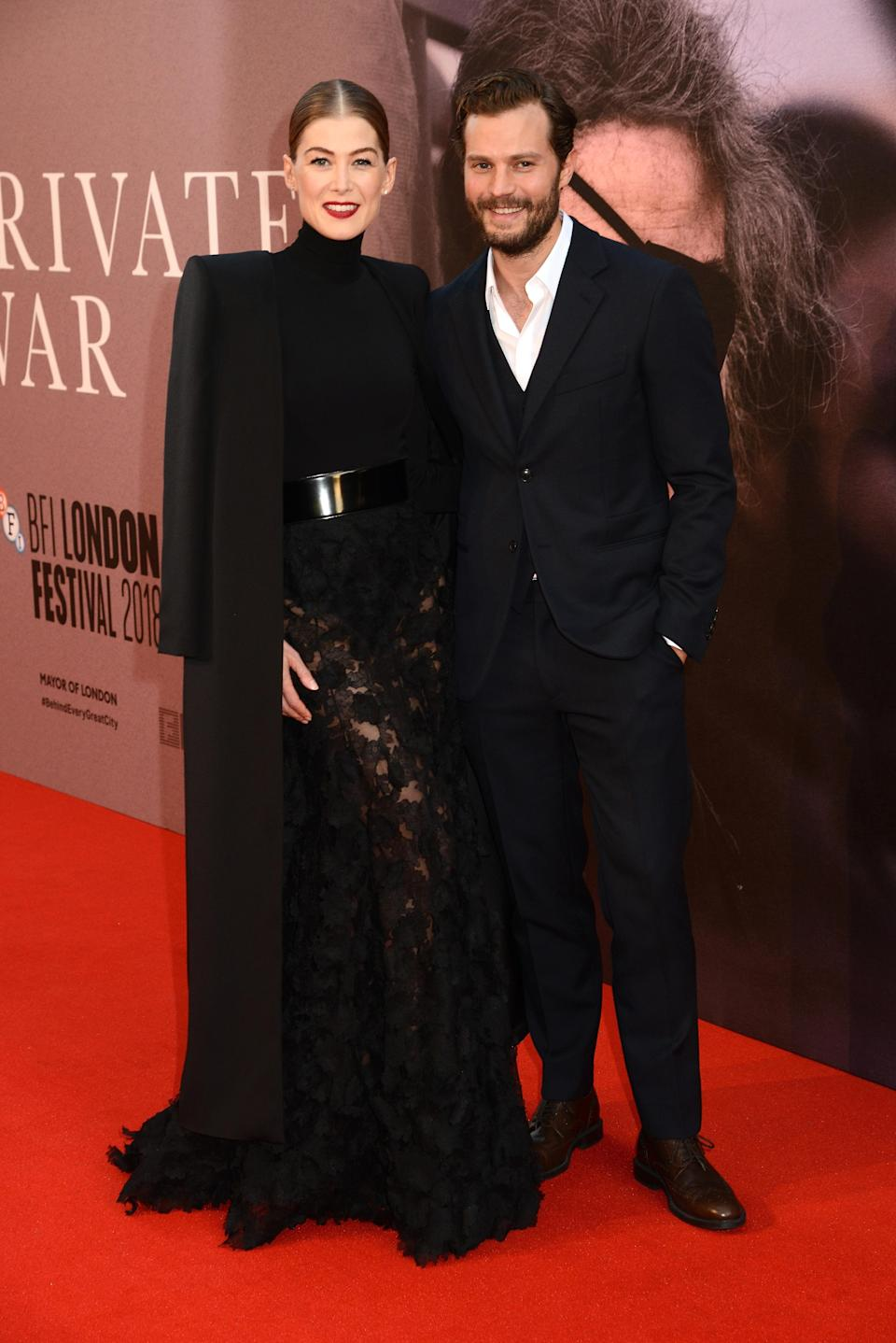 <p>Rosamund, in Givenchy haute couture, and Jamie took to the red carpet at the BFI London Film Festival to promote their new film, 'A Private War'. <em>[Photo: Getty]</em> </p>