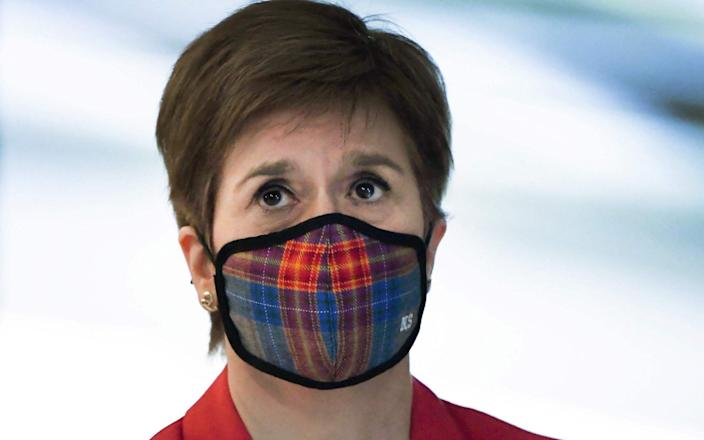 Scotland's First Minister Nicola Sturgeon wearing a face mask or covering due to the COVID-19 pandemic - ANDY BUCHANAN/AFP
