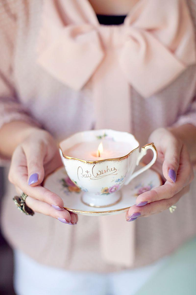 """<p>These candles will add a delicate touch to mom's nightstand or dresser. </p><p><em><strong>Get the tutorial from <a href=""""http://rhiannonbosse.com/2011/07/diy-vintage-teacup-candles.html"""" rel=""""nofollow noopener"""" target=""""_blank"""" data-ylk=""""slk:Rhiannon Bose"""" class=""""link rapid-noclick-resp"""">Rhiannon Bose</a>. </strong></em></p><p><strong><a class=""""link rapid-noclick-resp"""" href=""""https://www.amazon.com/gp/slredirect/picassoRedirect.html/ref=pa_sp_atf_aps_sr_pg1_1?ie=UTF8&adId=A0053783344Z8L8UPE1KO&url=%2FHearts-Crafts-Candle-Making-All-Natural%2Fdp%2FB07PCWGHD4%2Fref%3Dsr_1_2_sspa%3Fdchild%3D1%26keywords%3DWAX%2BFLAKES%26qid%3D1605822637%26sr%3D8-2-spons%26psc%3D1&qualifier=1605822637&id=623736690968424&widgetName=sp_atf&tag=syn-yahoo-20&ascsubtag=%5Bartid%7C10063.g.34832092%5Bsrc%7Cyahoo-us"""" rel=""""nofollow noopener"""" target=""""_blank"""" data-ylk=""""slk:SHOP WAX FLAKES"""">SHOP WAX FLAKES</a></strong></p>"""