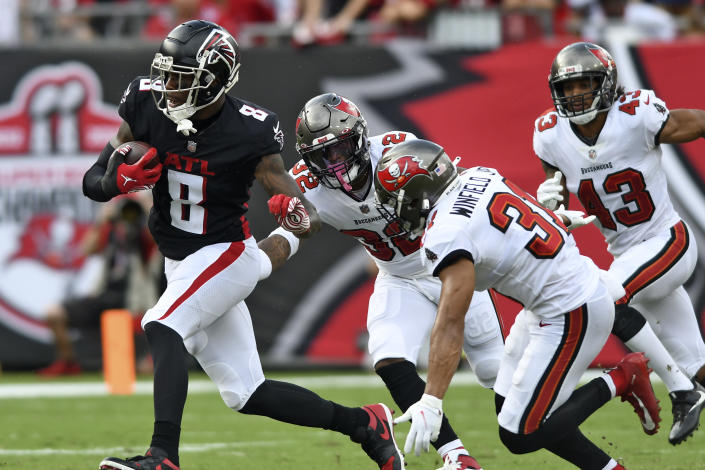 Atlanta Falcons tight end Kyle Pitts (8) gets away from Tampa Bay Buccaneers safety Mike Edwards (32), safety Antoine Winfield Jr. (31) and defensive back Ross Cockrell (43) after a catch during the first half of an NFL football game Sunday, Sept. 19, 2021, in Tampa, Fla. (AP Photo/Jason Behnken)