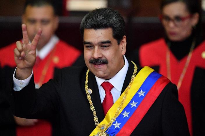Venezuela's President Nicolas Maduro flashes the victory sign after being sworn-in at the start of a second six-year term (AFP Photo/Yuri CORTEZ)