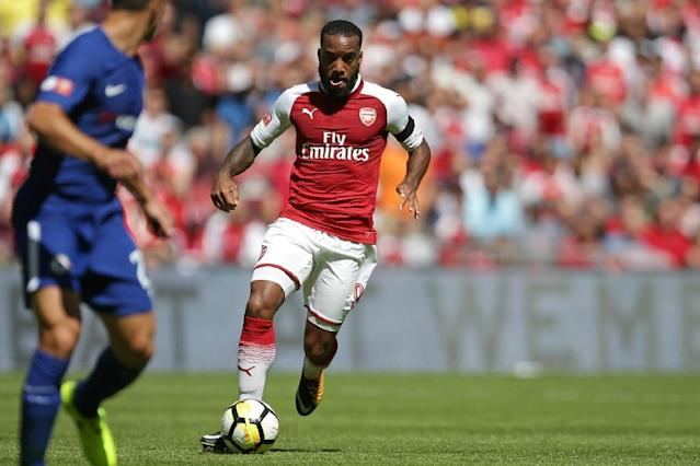 Arsenal's striker Alexandre Lacazette runs with the ball on August 6, 2017 (AFP Photo/Daniel LEAL-OLIVAS)