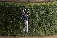 Milwaukee Brewers right fielder Ben Gamel (16) loses the ball off the bat of Chicago Cubs' Kyle Schwarber (12) during the eighth inning of a baseball game Friday, Aug. 14, 2020, in Chicago. (AP Photo/Jeff Haynes)