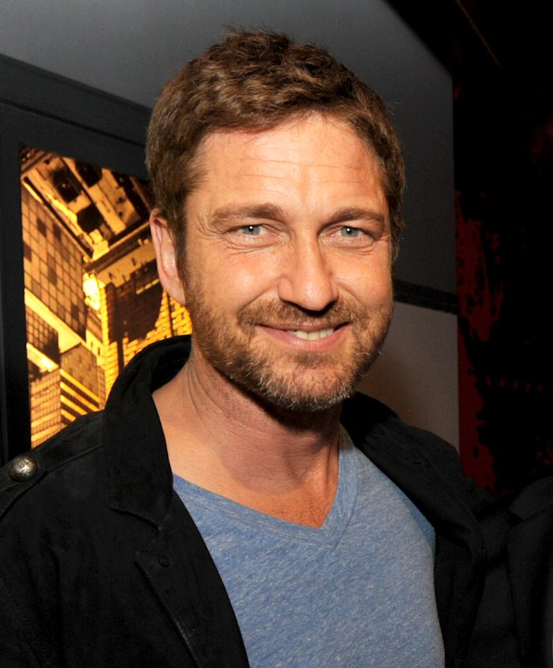 "LOS ANGELES, CA - JANUARY 23:  Actor Gerard Butler poses at the after party for the premiere of Relativity Media's ""Movie 43"" at Madame Tussaud's Hollywood on January 23, 2013 in Los Angeles, California.  (Photo by Kevin Winter/Getty Images)"