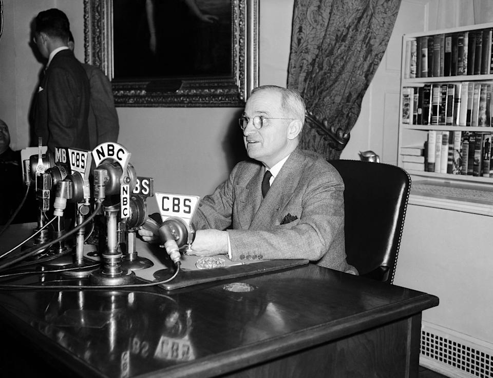 """FILE - In this April 25, 1945, file photo, U.S.  President Harry S. Truman, talks in front of microphones, over which he broadcasts a message opening the conference of 46 United Nations in San Francisco, telling the delegates """"you are to be architects of a better world. In your hands rests our future,"""" in the White House in Washington, D.C. Seventy years ago leaders of 50 war-weary countries gathered in San Francisco to create an international order that would save future generations """"from the scourge of war."""" With that, the United Nations was created. (AP Photo/File)"""