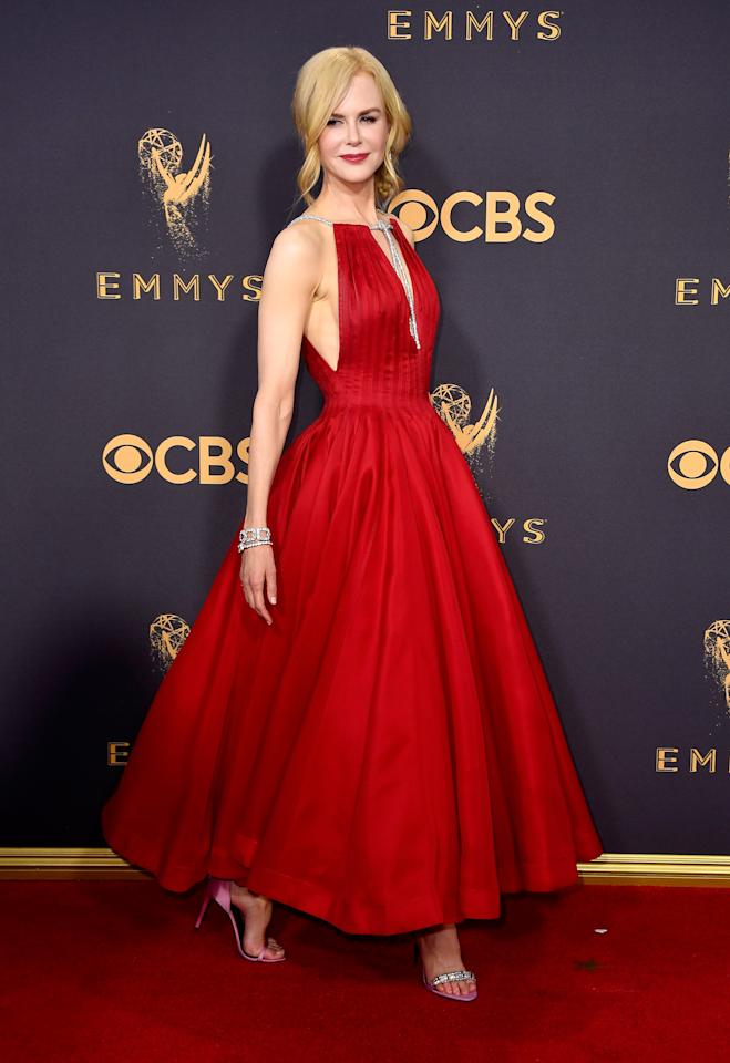 <p>Nicole's vivid red Calvin Klein gown was a dress made in heaven. <i>[Photo: Getty]</i> </p>